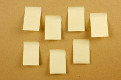 Blank sheets of paper stuck to the wall brown. Sheets of paper stuck to the wall brown Stock Photos