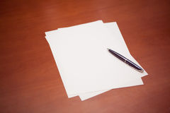 Blank sheets with pen for new ideas. Empty white sheets ready for new ideas and projects Royalty Free Stock Photography