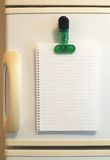 Blank shopping list. On fridge royalty free stock images