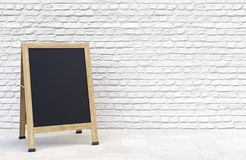 Blank sidewalk sign over brick wall. Wooden street sidewalk sign with blank menu chalk blackboard over white brick wall. 3D illustration Royalty Free Stock Photos