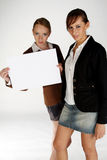 Blank Sign. Two girls holding a white blank sign to write your own message stock image