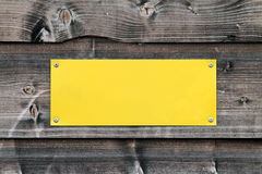 Blank sign. Blank yellow sign on old grey wooden wall stock images