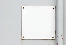 Blank sign. Blank steel sign on concrete wall stock photo