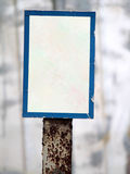 Blank sign. Blank white sign with blue boarder on rusty pole stock photos