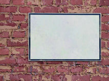 Blank sign. Blank white sign on brick wall stock photography