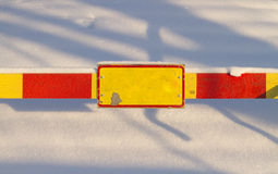 Blank sign. Blank red and yellow sign with snow background royalty free stock images