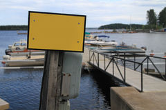 Blank sign. Blank yellow sign in small harbor royalty free stock photography