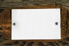 Blank sign. Blank white metal sign attached to wood with screws stock photography