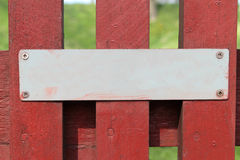 Blank sign. Blank metal sign on red wooden fence stock images