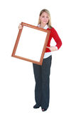 Blank sign. Pretty young woman holding a blank white framed sign, isolated on white, ready for your logo or text Royalty Free Stock Photos