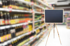 Blank sign blackboard in supermarket for menu advertise. Display Royalty Free Stock Images