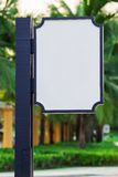 Blank sign board. White Blank sign board with blue pole in green park vector illustration
