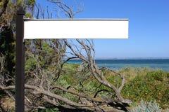 Blank sign board along the sea, destination scenics Royalty Free Stock Image