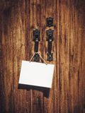 Blank sign board hanging on wooden door Stock Image