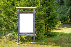 Blank sign board in the park Royalty Free Stock Photos
