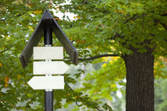 Blank sign boards against trees Stock Image