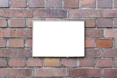 Blank sign on brick wall royalty free stock photography