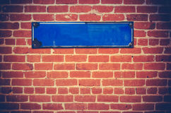 Blank Sign On A Brick Wall. A Blank Blue Sign For Your Text On A Red Brick Wall Stock Image