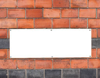 Blank sign on brick wall Stock Photography