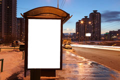 Blank sign at bus stop. In city stock images