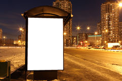 Blank sign at bus stop at evening city Stock Image