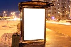 Blank sign at bus stop at evening Stock Photos