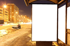 Blank sign at bus stop at evening. In city royalty free stock photo