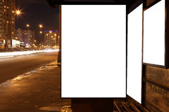 Blank sign at bus stop at evening in city Royalty Free Stock Images