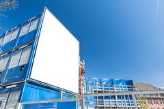 Blank sign on construction site with container homes. And fence stock photography