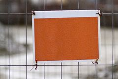 Blank sign on fence Stock Image