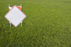Blank sign on field. Empty parks & recreation sign on a perfectly kept lawn. Script removed for your use stock images