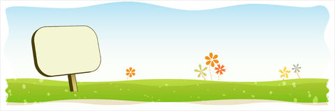 Blank sign in a field. With flowers Stock Photos