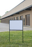 Blank Sign in Front of New Industrial & Warehouse Building Stock Photography