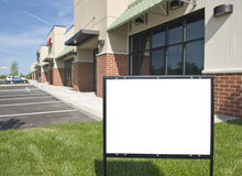 Blank Sign In Front of New Retail Strip Center Stock Photography