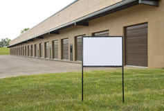 Blank Sign In Front of Warehouse & Industrial Building Royalty Free Stock Images