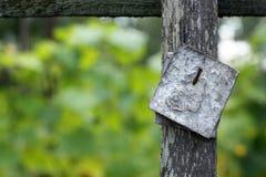 Blank sign in garden Stock Photo