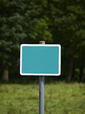 Blank sign. With green background in countryside Stock Image