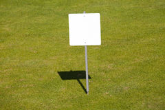 Blank sign. On the green field Stock Images