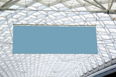 Blank sign hanged on ceiling. A blank sign hanging on the ceiling of the exhibition hall Stock Photography