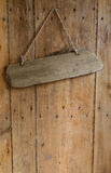 Blank sign hanging from a nail on an old rustic wooden oak wea Stock Photos