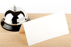 Blank Sign at Hotel. Service Bell with Blank Sign at Hotel Desk Stock Image
