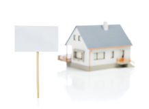 Blank sign and house model Royalty Free Stock Images