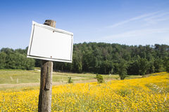 Blank sign indicating in the countryside Stock Images