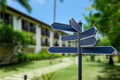 Blank sign label on a pole with blurred hotel resort background Stock Photo