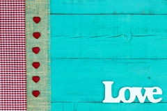 Blank sign with Love and fabric with hearts border Stock Photo