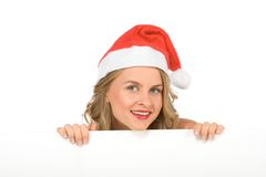 Blank sign - Mrs Santa Claus (with copy space). Blonde young woman in Mrs Santa Claus hat holding a blank sign. Isolated on white. Extra white space with your royalty free stock images