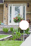 Blank sign outside home. A blank sign on the lawn of a private home or residence Stock Photo