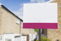 Blank sign outside a row of terraced houses Royalty Free Stock Photography