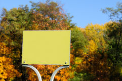Blank Sign Plate on Bright Autumn Tree Background Royalty Free Stock Photos