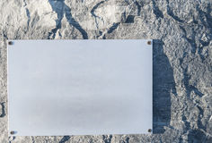 A blank sign plate on a stone wall Stock Photo